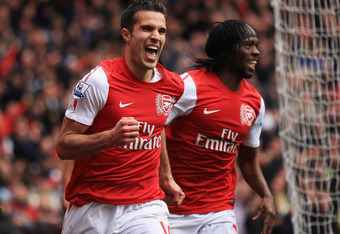LONDON, ENGLAND - MAY 05:  Robin van Persie of Arsenal celebrates scoring their third goal during the Barclays Premier League match between Arsenal and Norwich City at the Emirates Stadium on May 5, 2012 in London, England.  (Photo by Bryn Lennon/Getty Im