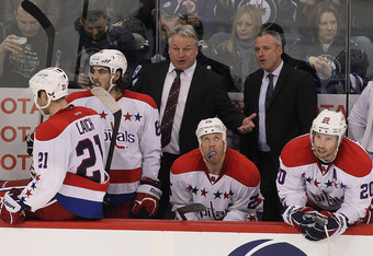 WINNIPEG, CANADA - MARCH 16: Washington Capitals head coach Dale Hunter talks to his team in the third period in a game against the Winnipeg Jets in NHL action at the MTS Centre on March 16, 2012 in Winnipeg, Manitoba, Canada. (Photo by Marianne Helm/Gett