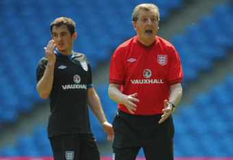 MANCHESTER, ENGLAND - MAY 24:  England manager Roy Hodgson shouts instuctions as :eighton Baines looks on during the England Training session on May 24, 2012 at the Etihad Stadium in Manchester, England.  (Photo by Michael Regan/Getty Images)