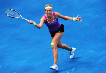 MADRID, SPAIN - MAY 12:  Victoria Azarenka of Belarus plays a backhand to Agnieszka Radwanske of Poland in her semi final match during the Mutua Madrilena Madrid Open tennis tournament at the Caja Magica on May 12, 2012 in Madrid, Spain.  (Photo by Jasper