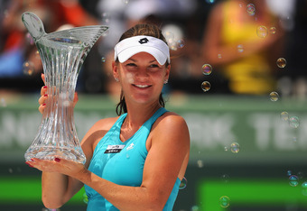 KEY BISCAYNE, FL - MARCH 31:  Agnieszka Radwanska of Poland celebrates with the trophy after beating Maria Sharapova of Russia in the women's singles final on day 13 of the Sony Ericsson Open on at Crandon Park Tennis Center on March 31, 2012 in Key Bisca