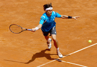 ROME, ITALY - MAY 18:  David Ferrer of Spain plays a forehand against Richard Gasquet of France in their quarter final match during day seven of the Internazionali BNL d'Italia 2012 at the Foro Italico Tennis Centre on May 18, 2012 in Rome, Italy.  (Photo