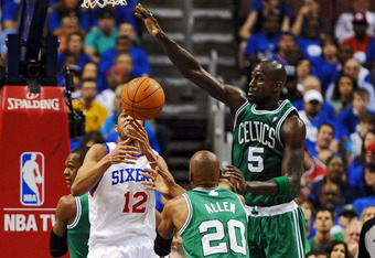 PHILADELPHIA, PA - MAY 23: Evan Turner #12 of the Philadelphia 76ers is fouled by Ray Allen #20 of the Boston Celtics as Kevin Garnett #5 tries to block in Game Six of the Eastern Conference Semifinals in the 2012 NBA Playoffs at the Wells Fargo Center on