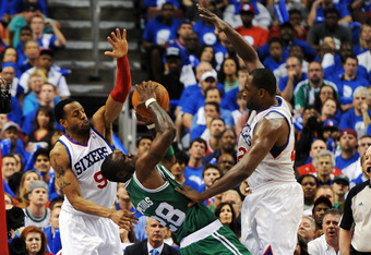 PHILADELPHIA, PA - MAY 23: Mickael Pietrus #28 of the Boston Celtics tries to pass the ball away from Andre Iguodala #9 and Elton Brand #42 of the Philadelphia 76ers in Game Six of the Eastern Conference Semifinals in the 2012 NBA Playoffs at the Wells Fa