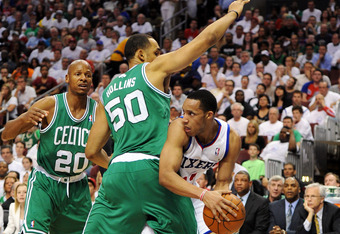 PHILADELPHIA, PA - MAY 18: Evan Turner #12 of the Philadelphia 76ers looks to pass from the defense of Ray Allen #20 and Ryan Hollins #50 of the Boston Celtics in Game Four of the Eastern Conference Semifinals in the 2012 NBA Playoffs at the Wells Fargo C