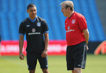 MANCHESTER, ENGLAND - MAY 24:  England manager Roy Hodgson speaks to Alex Oxlade-Chamberlain  during the England Training session on May 24, 2012 at the Etihad Stadium in Manchester, England.  (Photo by Michael Regan/Getty Images)