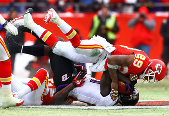 KANSAS CITY, MO - JANUARY 09:  Wide receiver Anquan Boldin #81 of the Baltimore Ravens is hit after a catch by safety Eric Berry #29 of the Kansas City Chiefs in the first half of their 2011 AFC wild card playoff game at Arrowhead Stadium on January 9, 20