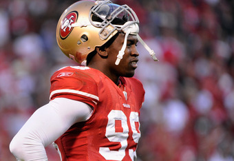 SAN FRANCISCO, CA - JANUARY 14:  Aldon Smith #99 of the San Francisco 49ers looks on during the NFC Divisional playoff game against the New Orleans Saints at Candlestick Park on January 14, 2012 in San Francisco, California.  (Photo by Thearon W. Henderso