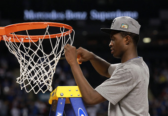 NEW ORLEANS, LA - APRIL 02:  Doron Lamb #20 celebrates as he cuts down the net after the Wildcats defeat the Kansas Jayhawks 67-59 in the National Championship Game of the 2012 NCAA Division I Men's Basketball Tournament at the Mercedes-Benz Superdome on