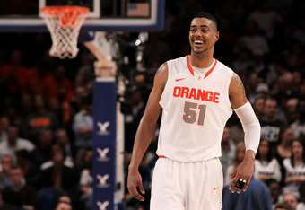 NEW YORK, NY - MARCH 08:  Fab Melo #51 of the Syracuse Orange reacts against the Connecticut Huskies during the quarterfinals of the Big East Men's Basketball Tournament at Madison Square Garden on March 8, 2012 in New York City.  (Photo by Jim McIsaac/Ge
