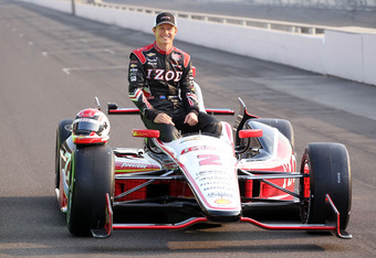INDIANAPOLIS, IN - MAY 20:  Ryan Briscoe the pole sitter for the Indianpolis 500 and driver of the IZOD Team Penske car poses on the track at Indianapolis Motor Speedway on May 20, 2012 in Indianapolis, Indiana.  (Photo by Andy Lyons/Getty Images)