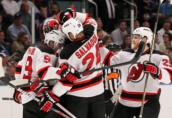 NEW YORK, NY - MAY 23:  Zach Parise #9, Travis Zajac #19, Ilya Kovalchuk #17, Mark Fayne #29 and Bryce Salvador #24 of the New Jersey Devils celebrate their 5 to3 win over the New York Rangers in Game Five of the Eastern Conference Final during the 2012 N