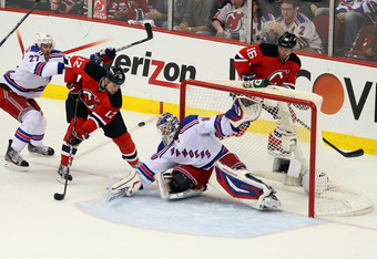 NEWARK, NJ - MAY 25:  Henrik Lundqvist #30 of the New York Rangers makes a save against Alexei Ponikarovsky #12 of the New Jersey Devils in Game Six of the Eastern Conference Final during the 2012 NHL Stanley Cup Playoffs at the Prudential Center on May 2