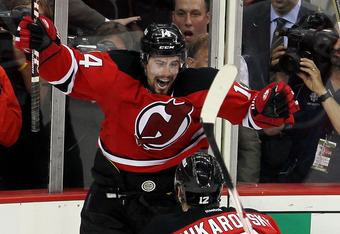 NEWARK, NJ - MAY 25:  Adam Henrique #14 of the New Jersey Devils celebrates with teammate Alexei Ponikarovsky #12  after scoring in overtime against the New York Rangers to win Game Six of the Eastern Conference Final and advance to the 2012 NHL Stanley C