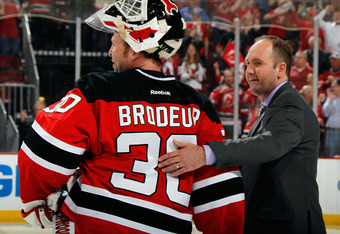 NEWARK, NJ - MAY 25:  Martin Brodeur #30 and head coach Peter DeBoer of the New Jersey Devils celebrate after defeating the New York Rangers by a score of 3-2 to win Game Six of the Eastern Conference Final during the 2012 NHL Stanley Cup Playoffs at the