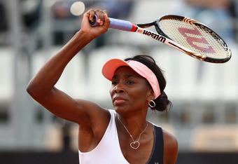 ROME, ITALY - MAY 18:  Venus Williams of the USA in action against Maria Sharapova of Russia in their quarter final match during day seven of the Internazionali BNL d'Italia 2012 at the Foro Italico Tennis Centre on May 18, 2012 in Rome, Italy.  (Photo by
