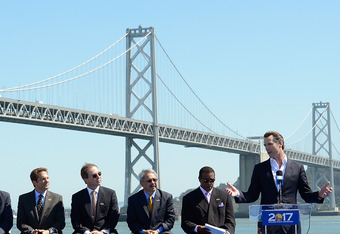 SAN FRANCISCO, CA - MAY 22:  Lieutenant Governor of California Gavin Newsom, a former San Francisco Mayor, speaks as (L-R) David Stern, Rick Welts, Peter Guber, Joe Lacob, Mayor Edwin M. Lee, Ahmad Rashad and former NBA great  Jerry West looks on at a pre