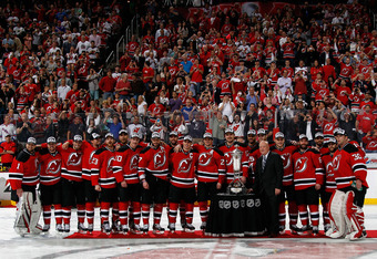 NEWARK, NJ - MAY 25:  The New Jersey Devils are presented with the Prince of Wales Trophy by NHL Deputy Commissioner Bill Daly after winning in Game Six of the Eastern Conference Final during the 2012 NHL Stanley Cup Playoffs against the New York Rangers