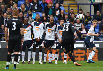 BOLTON, ENGLAND - APRIL 07:  Clint Dempsey of Fulham scores his first goal from a free kick during the Barclays Premier League match between Bolton Wanderers and Fulham at Reebok Stadium on April 7, 2012 in Bolton, England.  (Photo by Clive Brunskill/Gett