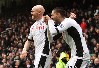 LONDON, ENGLAND - MARCH 04:  Fulham's Clint Dempsey (R) celebrates with teammate after scoring his second goal and Fulham's fifth goal of the match during the Barclays Premier League match between Fulham and Wolverhampton Wanderers at Craven Cottage on Ma