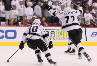 GLENDALE, AZ - MAY 22:  Jeff Carter #77 and Mike Richards #10 react after Dustin Penner scores the game-winning goal in overtime as the Kings defeat the Phoenix Coyotes 4-3 in Game Five of the Western Conference Final during the 2012 NHL Stanley Cup Playo