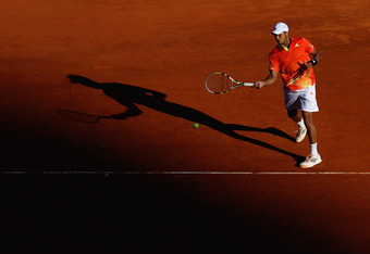MONTE-CARLO, MONACO - APRIL 20:  Jo-Wilfried Tsonga of France plays a forehand in his match against Gilles Simon of France during day six of the ATP Monte Carlo Masters on April 20, 2012 in Monte-Carlo, Monaco.  (Photo by Julian Finney/Getty Images)