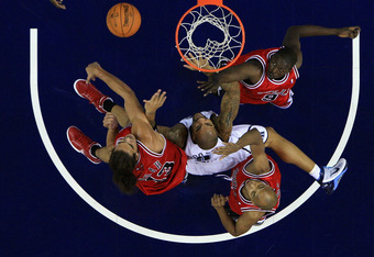 LONDON, ENGLAND - OCTOBER 06:  Taj Gibson (#22), Luol Deng (#9) and Joakim Noah (#13) of the Chicago Bulls battle for the rebound with Carlos Boozer (#5) of the Utah Jazz during the NBA pre-season game as part of the 2009 NBA Europe Live Tour between Chic