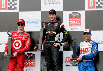 BIRMINGHAM, AL - APRIL 01:  Will Power of Australia, driver of the #12 Team Penske Chevrolet, Scott Dixon of New Zealand, driver of the #9 Target Chip Ganassi Racing Honda, and Helio Castroneves of Brazil, driver of the #3 Team Penske Chevrolet, pose with