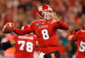 CHARLOTTE, NC - DECEMBER 27:  Mike Glennon #8 of the North Carolina State Wolfpack drops back to pass against the Louisville Cardinals during their game at Bank of America Stadium on December 27, 2011 in Charlotte, North Carolina.  (Photo by Streeter Leck