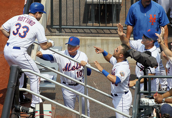 Vinny Rottino is congratulated after his first major league home run