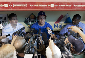 HOUSTON - MAY 18: Josh Hamilton #32 of the Texas Rangers talks with the media before playing the Houston Astros in game one of their Silver Boot Series at Minute Maid Park on May 18, 2012 in Houston, Texas.  (Photo by Bob Levey/Getty Images)