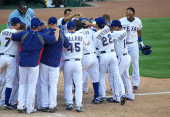 ARLINGTON, TX - MAY 26:  Josh Hamilton #32 of the Texas Rangers is congratulated by his teammates after hitting the game winning homerun against the Toronto Blue Jays at Rangers Ballpark in Arlington on May 26, 2012 in Arlington, Texas.  (Photo by Cooper