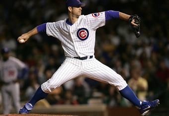 CHICAGO - AUGUST 30:  Starting pitcher Mark Prior #22 of the Chicago Cubs delivers the ball against the Los Angeles Dodgers on August 30, 2005 at Wrigley Field in Chicago, Illinois.  (Photo by Jonathan Daniel/Getty Images)