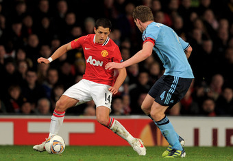 MANCHESTER, ENGLAND - FEBRUARY 23:   Javier Hernandez of Manchester United competes with Jan Vertonghen of Ajax during the UEFA Europa League Round of 32 second leg match between Manchester United and AFC Ajax at Old Trafford on February 23, 2012 in Manch