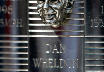 INDIANAPOLIS - MAY 26:  The bust of the late Dan Wheldon adorns the Borg-Warner Trophy for his victory at 2011 the Indianapolis 500, while displyed at the driver's meeting prior to the 96th Indianapolis 500 Mile Race at Indianapolis Motor Speedway on May