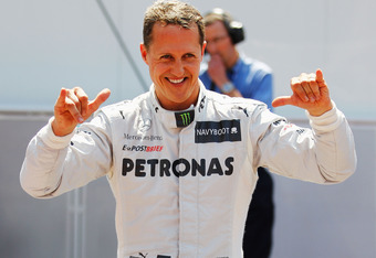MONTE CARLO, MONACO - MAY 26:  Michael Schumacher of Germany and Mercedes GP celebrates setting the fastest time before his five place grid penalty during qualifying for the Monaco Formula One Grand Prix at the Circuit de Monaco on May 26, 2012 in Monte C