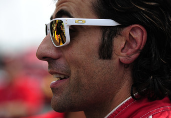 INDIANAPOLIS, IN - MAY 25:  Dario Franchitti of Scotland, driver of the #50 Target Chip Ganassi Dallara Honda, wears white sunglasses as a tribute to Dan Wheldon during the pit stop challenge on Carb Day for the Indianapolis 500 on May 25, 2012 at the Ind