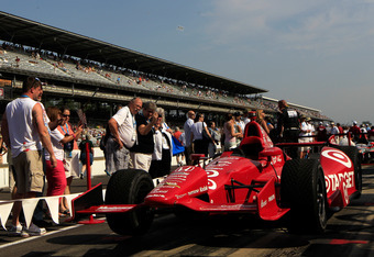 INDIANAPOLIS, IN - MAY 27:  A fan admire the #50 Target Chip Ganassi Racing Honda driven by Dario Franchitti (not pictured) on pit road prior to the IZOD IndyCar Series 96th running of the Indianpolis 500 mile race at the Indianapolis Motor Speedway on Ma