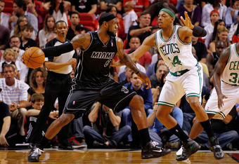 MIAMI, FL - APRIL 10:  LeBron James #6 of the Miami Heat posts up Paul Pierce #34 of the Boston Celtics during a game  at American Airlines Arena on April 10, 2012 in Miami, Florida. NOTE TO USER: User expressly acknowledges and agrees that, by downloadin
