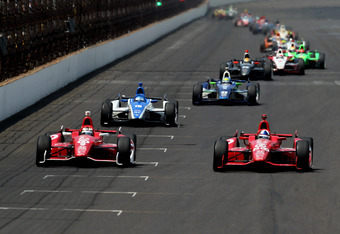 INDIANAPOLIS, IN - MAY 27:  Dario Franchitti (R) of Scotland, driver of the #50 Target Chip Ganassi Racing Honda, gets ahead of teammate Scott Dixon (L) of New Zealand, driver of the #9 Target Chip Ganassi Racing Honda, during the IZOD IndyCar Series 96th