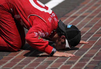 INDIANAPOLIS, IN - MAY 27:  Dario Franchitti of Scotland, driver of the #50 Target Chip Ganassi Racing Honda, kisses the yard of bricks in celebration of winning the IZOD IndyCar Series 96th running of the Indianapolis 500 mile race at the Indianapolis Mo