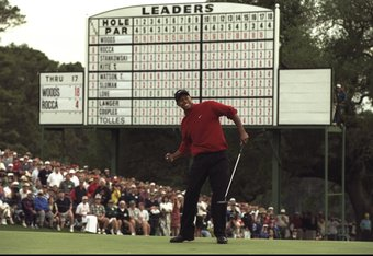 13 Apr 1997: Tiger Woods of the USA celebrates after sinking a 4 feet putt to win the US Masters at Augusta, Georgia. Woods won the tournament with a record low score of 18 under par. \ Mandatory Credit: Stephen Munday /Allsport