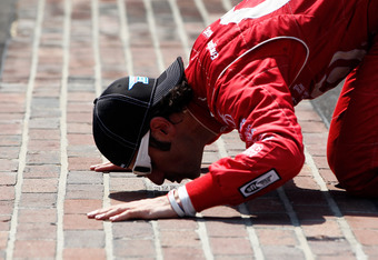 INDIANAPOLIS, IN - MAY 27:  Dario Franchitti of Scotland, driver of the #50 Target Chip Ganassi Racing Honda, kisses the yard of bricks in celebration of winning the IZOD IndyCar Series 96th running of the Indianpolis 500 mile race at the Indianapolis Mot