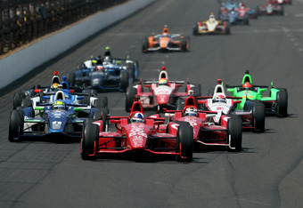 INDIANAPOLIS, IN - MAY 27:  Dario Franchitti of Scotland, driver of the #50 Target Chip Ganassi Racing Honda, leads a pack of cars including Tony Kannan, driver of the #11 GEICO-Mouser Electronics KVRT Chevrolet and Scott Dixon of New Zealand, driver of t