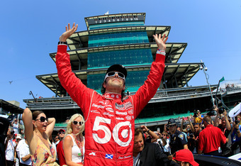 INDIANAPOLIS, IN - MAY 27:  Dario Franchitti of Scotland, driver of the #50 Target Chip Ganassi Racing Honda celebrates as his wife actress Ashley Judd (L) and Susie Wheldon (2nd L), wife of the late Dan Wheldon look on during the IZOD IndyCar Series 96th