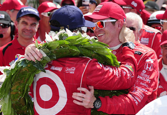 INDIANAPOLIS, IN - MAY 27:  Scott Dixon (R) of New Zealand, driver of the #9 Target Chip Ganassi Racing Honda congratulates Dario Franchitti of Scotland, driver of the #50 Target Chip Ganassi Racing Honda in victory lane after Franchitti won the IZOD Indy