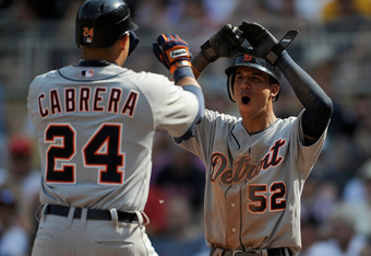 MINNEAPOLIS, MN - MAY 27: Quintin Berry #52 of the Detroit Tigers congratulates Miguel Cabrera #24 on scoring against the Minnesota Twins during the ninth inning on May 27, 2012 at Target Field in Minneapolis, Minnesota. The Tigers defeated the Twins 4-3.