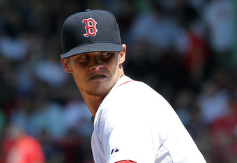 BOSTON, MA - MAY 27:  Clay Buchholz #11 of the Boston Red Sox throws against the Tampa Bay Rays at Fenway Park May 27, 2012  in Boston, Massachusetts. (Photo by Jim Rogash/Getty Images)