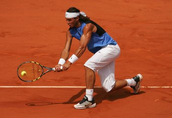 PARIS - JUNE 11:  Rafael Nadal of Spain in action against Roger Federer of Switzerland during the Men?s Singles Final on day fifteen of the French Open at Roland Garros on June 11, 2006 in Paris, France.  (Photo by Matthew Stockman/Getty Images)
