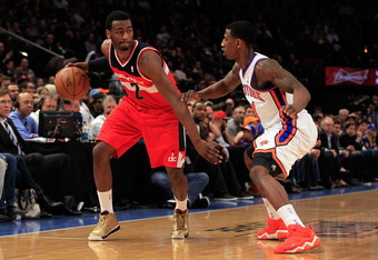 NEW YORK, NY - APRIL 13: John Wall #2 of the Washington Wizards drives against Iman Shumpert #21 of the New York Knicks at Madison Square Garden on April 13, 2012 in New York City. NOTE TO USER: User expressly acknowledges and agrees that, by downloading